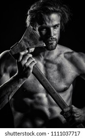 Strength and power. Young guy with ax. Strong man concept. Straight razor. Danger and passion. Attractive sexy man. Black and white vintage photo. Naked male body. Torso with abs. Beautiful man face