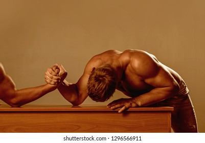 Strength and resistance. Men competitors try to win victory or revenge. Strength skills. Revenge in sport. Twins men competing till victory. Twins competitors arm wrestling.