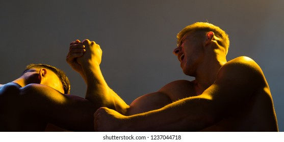 Strength skills. Twins men competing till victory. Twins competitors arm wrestling. Men competitors try to win victory or revenge. Revenge in sport. Strength does not come from winning.