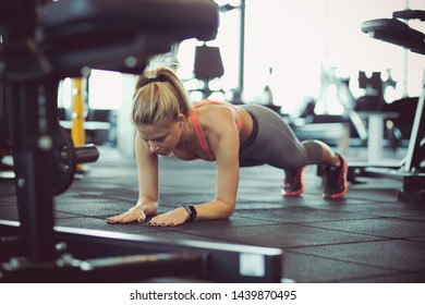 Strengthen the muscles. Woman at gym.