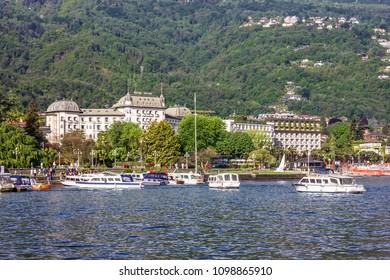 Stresa, Italy - May 25, 2018: Tourist yachts in Stresa, Regina hotel Como lake view.