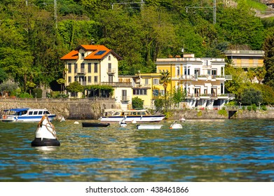 STRESA, ITALY - MAY 3, 2016: Houses on the shore of Lago Maggiore (Big Lake), Piedmont, Italy. Lago Maggiore is the second largest lake in Italy