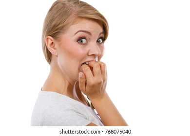 Stress, anxiety, emotions and problems concept. Scared, stressed woman biting her nails