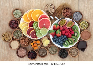 Stress and anxiety relieving health foods, herbs, spices and supplement powders that also help relaxation and reduce chronic fatigue and depression. Top view on oak wood table.