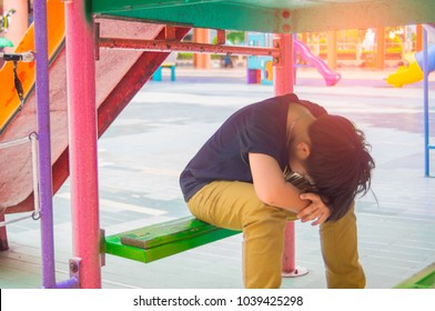 Stress of Asian boys In the playground of the school. Children's fun may disappear if parents do not pay attention to their feelings.