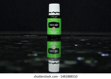 Stress Away Young Living Essential Oils Blend on black granite - San Antonio, Texas, USA -  August 17, 2019