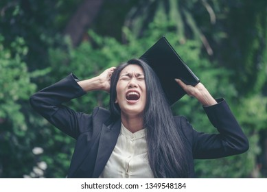 Stress business woman shocked and scream after got bad frustrated  unacceptable business news. Insult dilemma woman with anxious stressful from work. Middle age woman crisis problem concept.