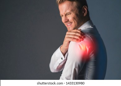 stress caucasian businessman officer feel bad with work hard and office syndrome hand touch painful body part