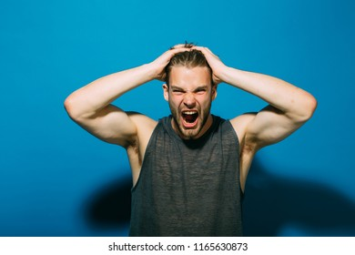 Stress concept. Stressed man pull out hair on head of stress. Handsome man shout with stress. Give your stress wings and let it fly away.
