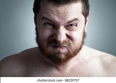 Stress or constipation concept - man with funny grimace