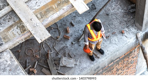 Stress, depress and hopeless engineer or architect construction site.. He is having problems in work. Engineering concept. Top view.