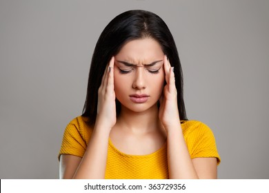 Stress and Headache. Young Woman having Migraine Pain