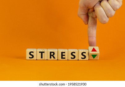 Stress level symbol. Doctor turns a cube and changes the expression 'stress up' to 'stress down'. Beautiful orange background. Medical, stress level concept. Copy space. - Shutterstock ID 1958521930