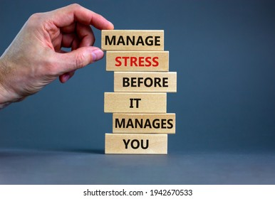Stress management symbol. Wooden blocks with words manage stress before it manages you. Beautiful grey background. Doctor hand. Psychological, business and stress management concept. Copy space.