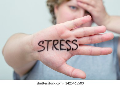 Stress. Overweight woman. Eating problems. Bulimia, compulsive overeating. Sugar addiction, weight gain.
