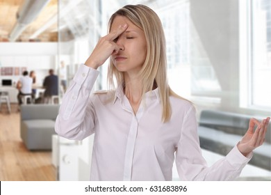 Stress relief concept young business woman doing breathing exercises in an office