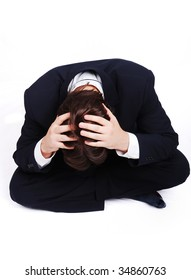 Stress situation, young man with hands on his head