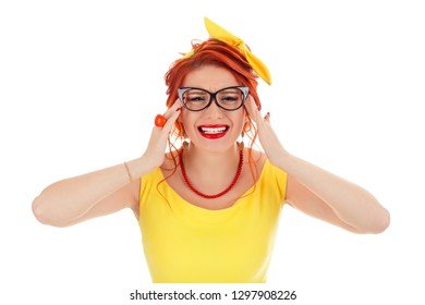 Stress. Woman stressed is going crazy hands on head in frustration. Caucasian person in yellow dress and coral necklace with red lipstick, redhead hair isolated on white studio background