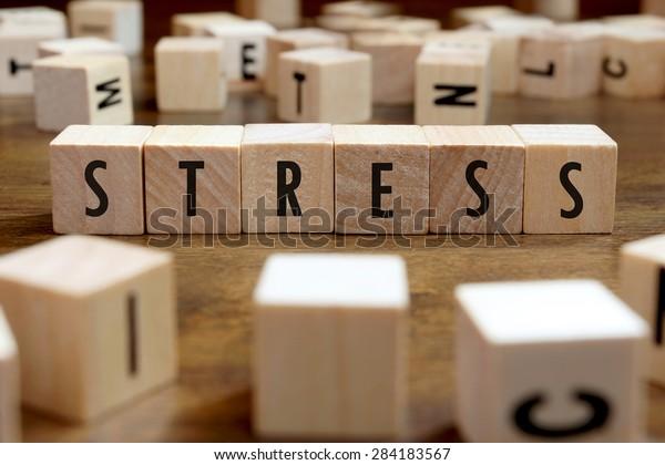 stress word written on wood block