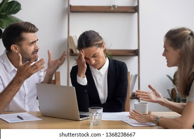 Stressed annoyed office employee manager having headache migraine at business meeting with complaining client customer tired of angry colleagues arguing shouting having conflict dispute at workplace