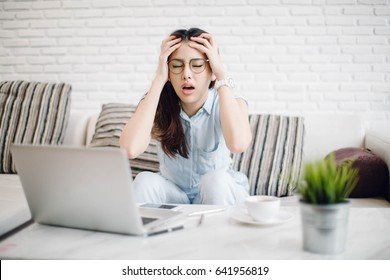 stressed Asia woman with computer at home