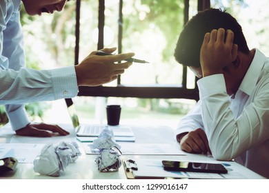 Stressed asian businessman getting trouble from mistake. conflict between male workers at workplace. Teamwork planners have conflict of interest between partner and coworker