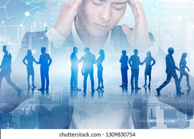 Stressed Asian businessman portrait in city with his colleagues silhouettes and polygonal network in the sky. Toned image double exposure