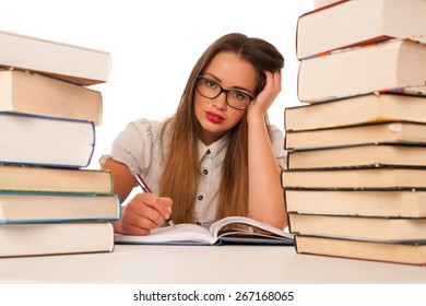Stressed asian caucasian woman student learning in tons of books isolated