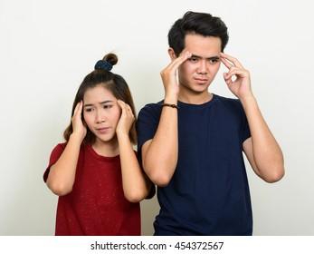Stressed Asian teenage couple