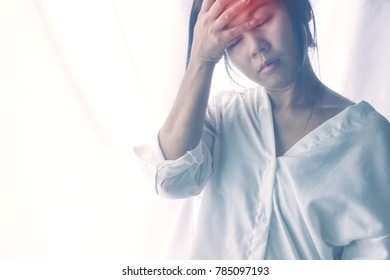 stressed Asian woman having headache and feeling dizzy from migraine ,unhealthy concept