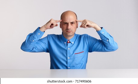 stressed business man with headache holds hands on head, isolated