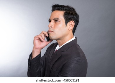 Stressed business man on his cellphone