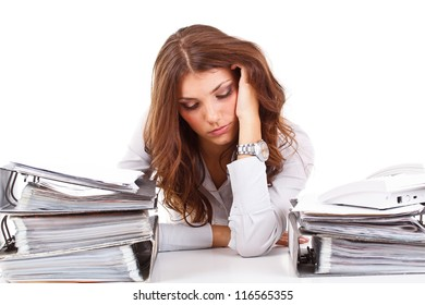Stressed business woman sitting behind the desk