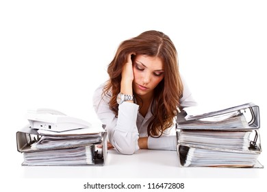 Stressed business woman working at her office