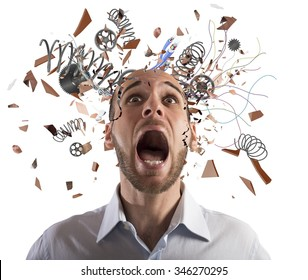 Stressed businessman with broken mechanism head screams