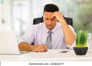 stressed businessman having headache at work