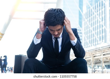 Stressed businessman with head in hands in his office. Business travel concept