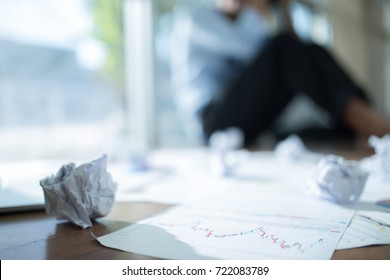 Stressed businessman with head in hands at office, Business failure concept, Blurred background