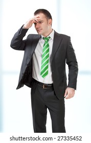 stressed businessman with his hands to his head