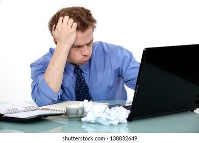 Stressed businessman making no progress