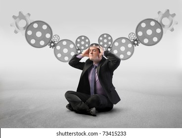 Stressed businessman with mechanisms on the background