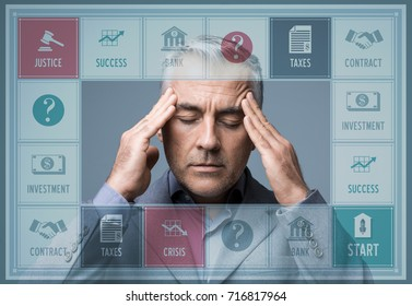 Stressed businessman playing a conceptual business board game, business challenges and strategy concept