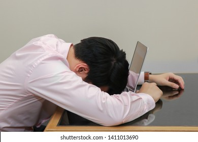 stressed businessman sleep on his laptop with burnout syndrome