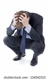 Stressed businessman in suit hands in his hair