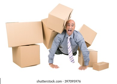 Stressed businessman under a pile of cardboard boxes