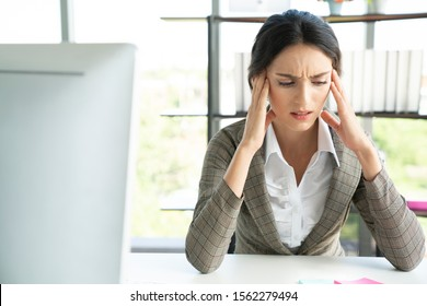 Stressed businesswoman doing paperwork at an office,  Stress concept
