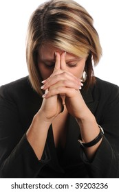 Stressed businesswoman with hands on face over white background