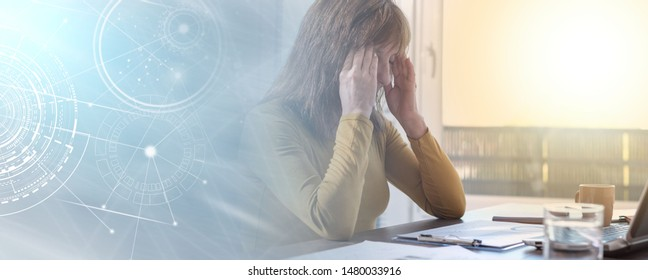 Stressed businesswoman holding hands on temples in office; light effect