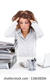 Stressed businesswoman is overworked at her desk