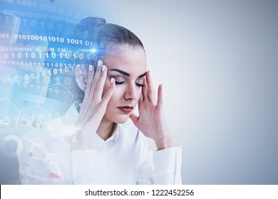 Stressed businesswoman portrait near gray wall with binary numbers interface and business infographics. Concept of too much information. Toned image double exposure mock up